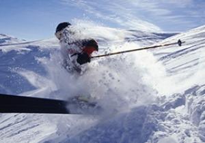 Main skiing down mountain