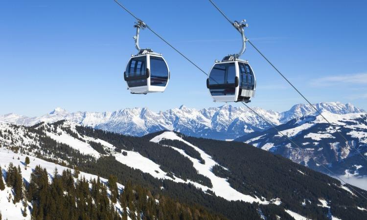 Two gondolas over mountain