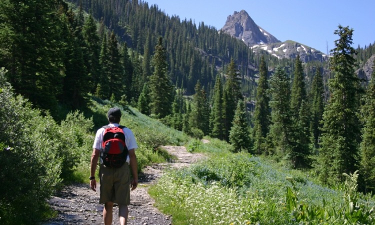 Man hiking up mountain trail